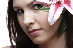 Girl with tiger lily Stock Images