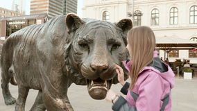 Girl with the tiger in Oslo.  stock footage