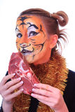 Girl tiger with the piece of raw meat. Stock Photos