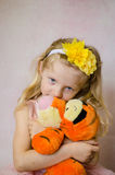 Girl with tiger toy Royalty Free Stock Image
