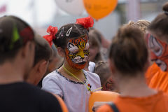 Girl tiger. Vladivostok, Primorsky Region, Russia – September 27th, 2015: Vladivostok, the downtown, the holiday Day of a Tiger, children made paints a tiger Stock Photo
