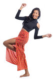 Girl tilts her body back and throws her knee forward. Afrodescen Royalty Free Stock Photo