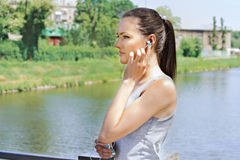 Girl at the time of exercise is listening to music Royalty Free Stock Photography