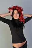 Girl with tinsel. Pretty girl with red tinsel on head Royalty Free Stock Photography