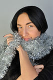 Girl with tinsel. Girl with silver tinsel scarf Stock Photo