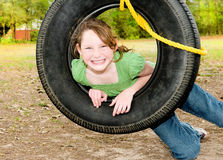Girl on tire swing Stock Images