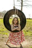 Child in tire swing Stock Images
