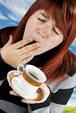 Girl tired preparing to drink coffee Royalty Free Stock Images