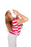 Girl with tissue on her nose. Royalty Free Stock Photography