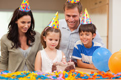 Girl about to blow out the candles on her birthday cake Royalty Free Stock Photos
