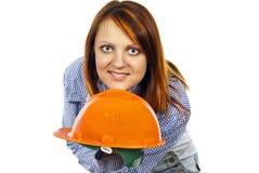 Girl to builder the helmet royalty free stock photo