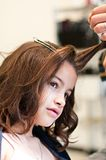 Girl to the hairdresser Stock Images