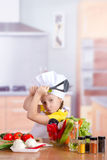 Girl to have fun in the kitchen Stock Images