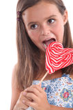 Girl about to lick lollipop Royalty Free Stock Photography