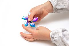 Girl to play with Fidget Spinner in his hands, the concept of relieving stress, develop a small hand mathematics. Girl to play with Fidget Spinner in his hands stock images