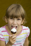 Girl to screw up one's eyes with ice-cream Stock Photography