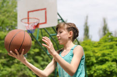 Girl about to shoot basketball Stock Photos