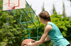 Girl about to shoot basketball Stock Image