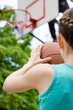 Girl about to shoot basketball Stock Photo
