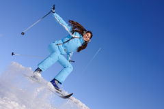 Girl to ski down. Young pretty teenager girl to ski down a mountain slope Royalty Free Stock Photo