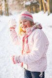 Girl About To Throw Snowball In Snowy Woodland Stock Photos