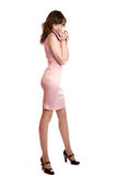 Girl to the utmost in a pink dress on  white Royalty Free Stock Image