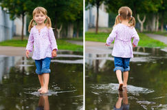Girl to walk barefoot in a puddle Royalty Free Stock Photos