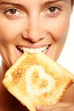 Girl and toast Royalty Free Stock Images