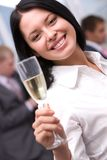 Girl toasting Stock Images
