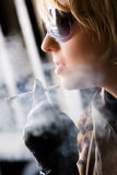 Girl and tobacco Royalty Free Stock Images