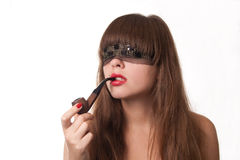 Girl with tobacco pipe. The beautiful girl blindfold and a pipe in lips Stock Photography