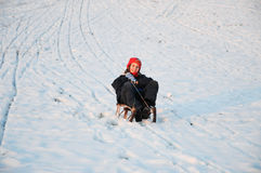 Girl on toboggan Royalty Free Stock Photo
