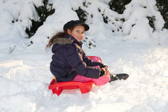 Girl with toboggan in the snow Royalty Free Stock Image