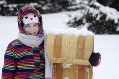 Girl with toboggan Stock Photos