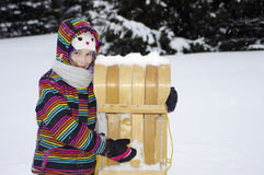Girl with toboggan Stock Image