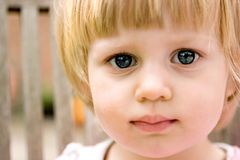 Girl toddler looking curious. Royalty Free Stock Photo