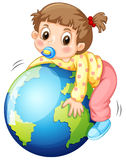 Girl todler hugging the earth Stock Images