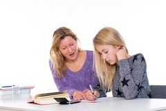 Girl and together with teacher in the classroom. Girl learning together with teacher in the classroom stock photography