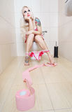 Girl in the toilet Royalty Free Stock Photography