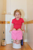 Girl in a toilet Royalty Free Stock Image