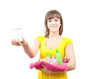 Girl with toilletries. Girl in yellow dress with colored toilletries on towel royalty free stock image