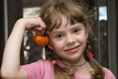 Girl with tomato Royalty Free Stock Photography