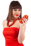 Girl with tomato Royalty Free Stock Images