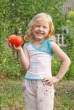 Girl with tomato Royalty Free Stock Image