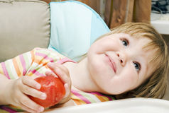 Girl with tomato Royalty Free Stock Photo
