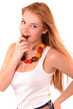Girl and tomato. Girl biting a tomato, a girl with a necklace made of tomatoes royalty free stock images