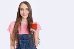 Girl with tomato juice Royalty Free Stock Photo