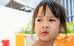 Girl with tomato sauce on her mouth Royalty Free Stock Photos