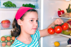 Girl with tomatoes Royalty Free Stock Photography