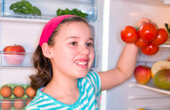 Girl with tomatoes Royalty Free Stock Images